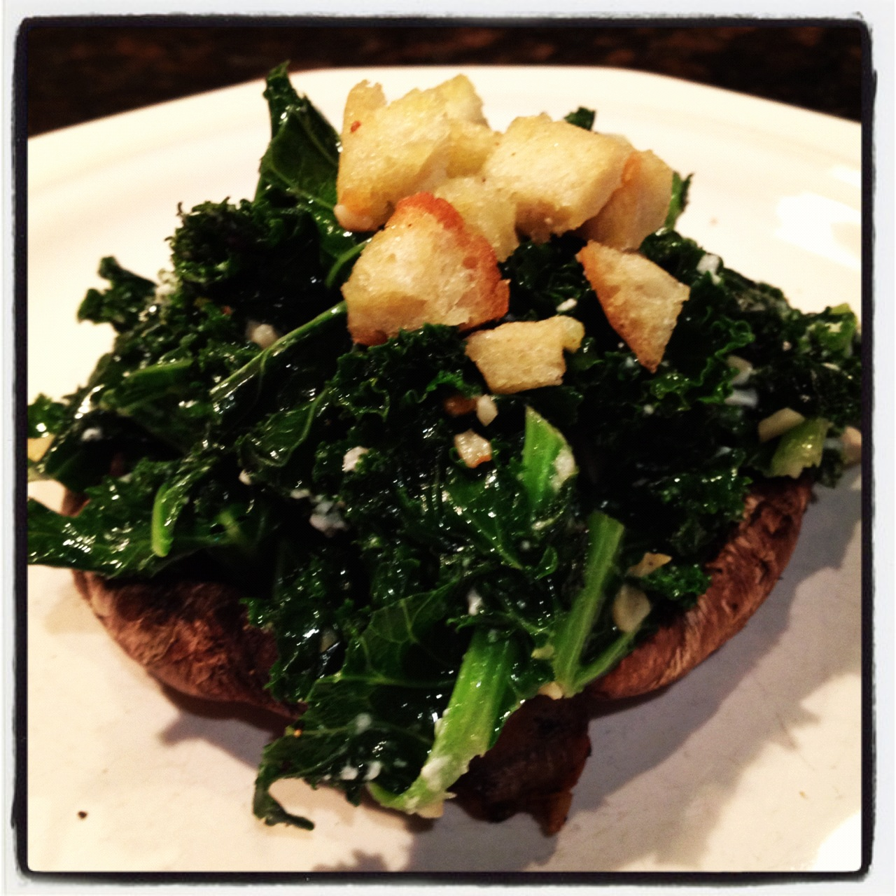Grilled Portobello Mushrooms with Sautéed Kale and Goat Cheese